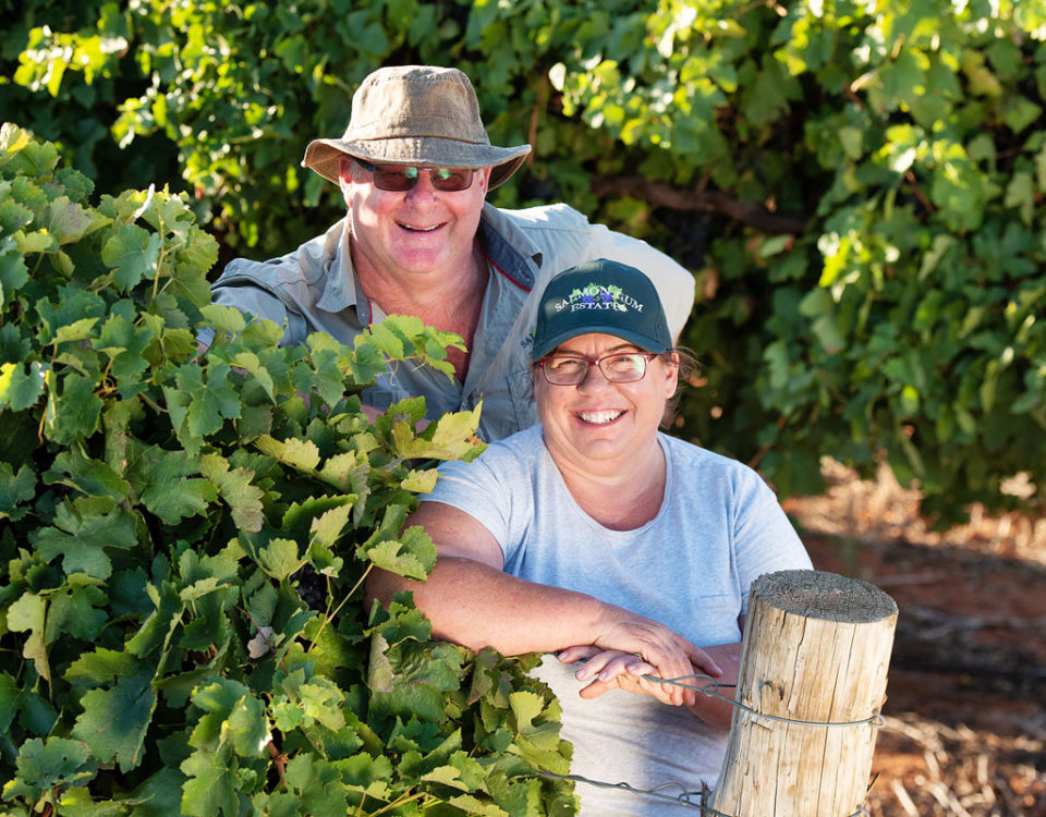 Peter and Jacque Schulz standing in their Murray River vineyard