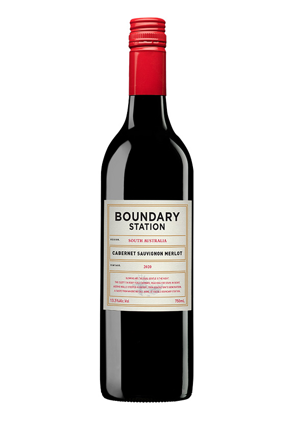 Black wine bottle with red cap and red and black text on cream label